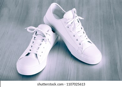 fashionable and beautiful footwear of white color closeup for sports activities or for comfortably to go
