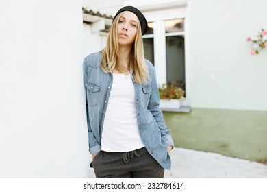 Fashionable beautiful girl standing in pose