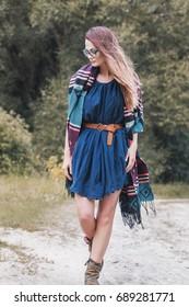 fashionable beautiful woman shooting a lookbook on nature