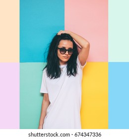 fashionable and beautiful woman in stylish pose in a white oversize dress on colorful background. wedding concept bride