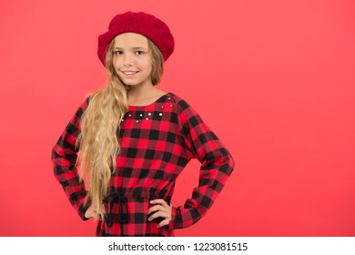 Fashionable beret accessory for female. How to wear french beret. Beret style inspiration. How to wear beret like fashion girl. Kid little cute girl with long hair posing in hat red background.