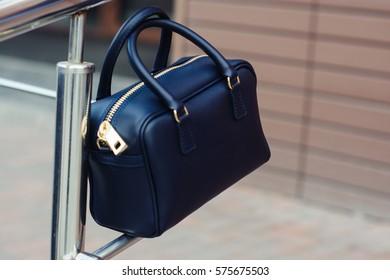 fashionable black handbag in the city