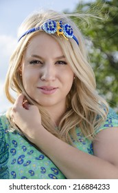 Fashionable blonde outdoors with butterfly headband