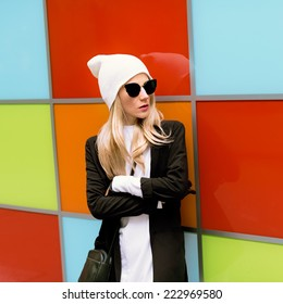 fab178e118ee Fashionable Blonde standing against a bright wall. Urban Autumn style