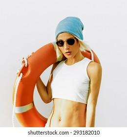 Fashionable Blonde. Summer. Lifebuoy. Fashion style beach