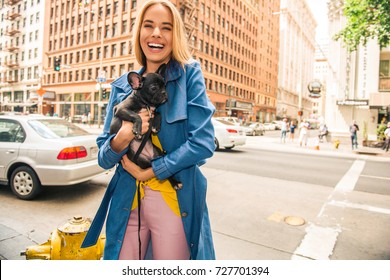 Fashionable Blonde Woman In Jeans Coat And Nice Clothes Yellow Purse Walking The Street