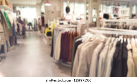 fashionable boutique clothing store shop in shopping mall defocused blur background