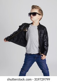 Fashionable child in leather coat.little boy in sunglasses. Autumn fashion