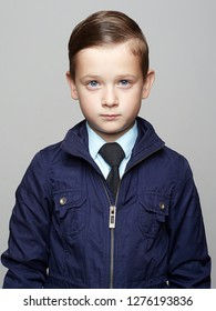 fashionable child with trendy haircut. fashion  little boy with blue eyes. elegant kid in tie, business child, hair style