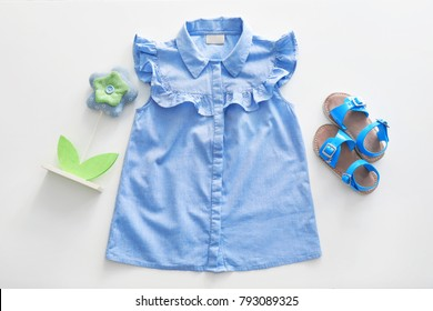 Fashionable children dress and shoes on white background