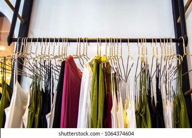 Fashionable clothes in a boutique store