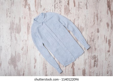 Fashionable concept. Blue striped shirt. Top view