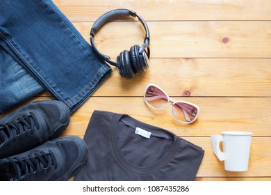 Fashionable concept, men's clothes with accessories items on wooden board background with copy space
