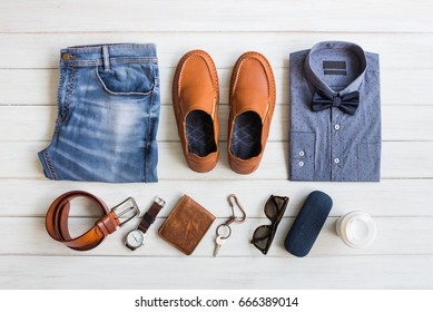 Fashionable concept, men's clothes with accessories items on white wooden board background