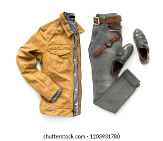 Fashionable concept, men's clothing set with loafer shoe,  jeans, yellow jacket, shirt, watch and belt isolated on a white background. pack shots, top view