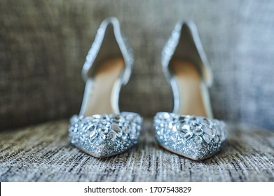 fashionable expensive silver grey high heels on a textured surface