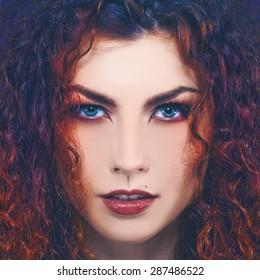 Fashionable female portrait. Vogue style redhead girl.