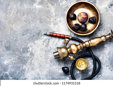 Fashionable fruit smoking hookah with a tobacco flavor of figs.Eastern shisha.Smoking hookah.
