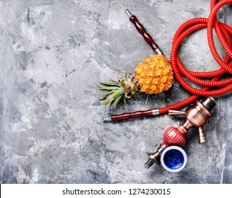 Fashionable fruit smoking hookah with a tobacco flavor of pineapple.Eastern shisha.Smoking hookah.