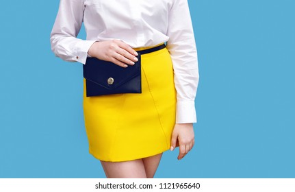 Fashionable girl with black waist pack belt bag. Bright outfit