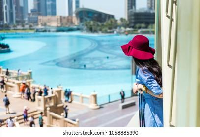 Fashionable girl enjoying the view at Dubai mall