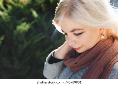 fashionable girl on an autumn walk, girl is walking in the park, travel in the autumn