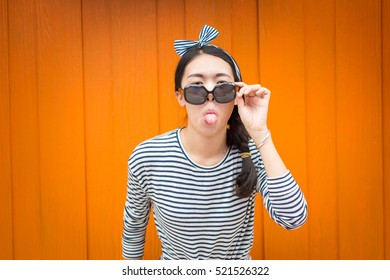 Fashionable girl posing against colorful wooden backdrop