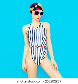 Fashionable Girl in vintage swimsuit. Nautical style. Summer fashion ?ccessories. Scarf and Glasses.