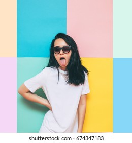 fashionable girl in a white oversized t-shirt dress shows her tongue. bright and crazy cool  bride. wedding concept.