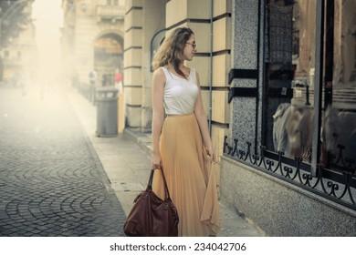 Fashionable girl window shopping