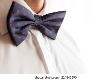 A fashionable groom wears a bowtie