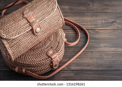 Fashionable handmade natural organic rattan bags on green background. Ecobags from Bali. Eco-bag concept.