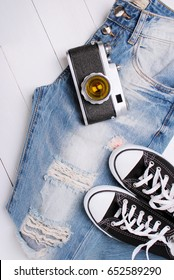fashionable jeans with sneakers on a white background