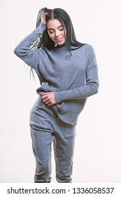 Fashionable knitwear. Female knitwear. Knitwear concept. Feel warm and comfortable. Woman wear grey textile suit blouse and pants. Warm comfortable clothes. Casual style fashion for every day.