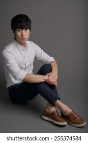 Fashionable Korean man sitting on the floor