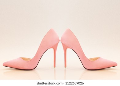 fashionable ladies pink high heels on bright pink background.