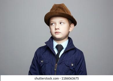 fashionable little boy in hat. fashion child portrait. elegant kid in tie, business child