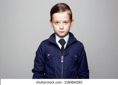 fashionable little boy. suits. fashion child portrait. elegant kid in tie, business child