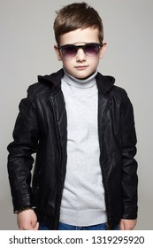 fashionable little boy in sunglasses. stylish kid in leather. fashion children