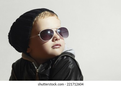 Fashionable little boy in sunglasses.Child.Winter style.Kids fashion.Little model in black cap