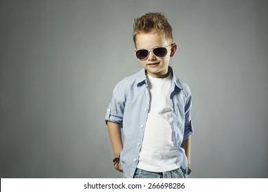 fashionable little boy in sunglasses.stylish kid in jeans. fashion children