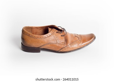 Fashionable male brogue shoe on white background view from above
