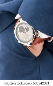 Fashionable man holding his hand in pocket with wrist watch in closeup as fashion luxury concept