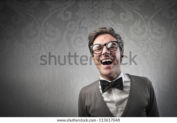 Fashionable man laughing