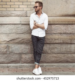 Fashionable man posing in old city.Lifestyle
