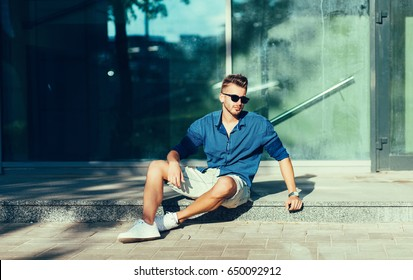 Fashionable man in a shirt and sunglasses. Summer clothes season