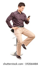 Fashionable man texting by a mobile phone isolated on white background