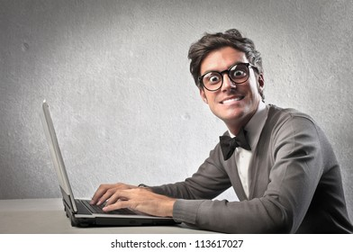 Fashionable man using a laptop computer