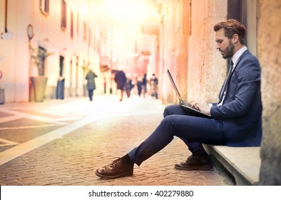 Fashionable manager sitting outdoors