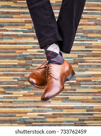 fashionable men's shoes with beautiful feet in socks